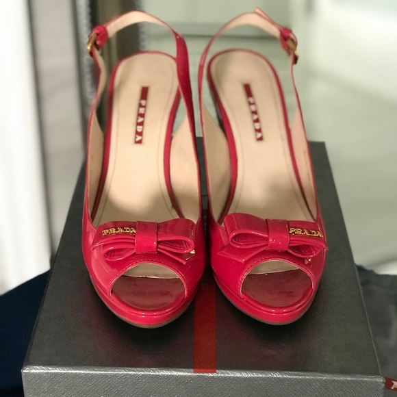 Prada Shoes - Prada like new in box patent pink wedges with logo